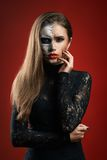 Beautiful woman with makeup skeleton stock photo