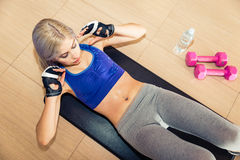 Beautiful woman making abs training on the floor Stock Image