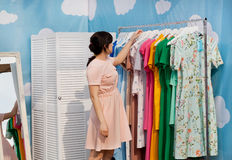 Beautiful woman making choice in showroom of bright fashion store Royalty Free Stock Photos