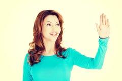 Beautiful woman making choose on abstract screen Stock Photo