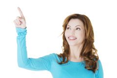 Beautiful woman making choose on abstract screen Royalty Free Stock Photos