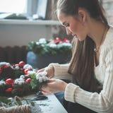 Beautiful Woman Making Christmas Decorations Stock Photography