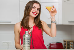 Beautiful woman making a cocktail Royalty Free Stock Photos
