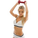 Beautiful woman is making exercises with dumbbells Stock Photo