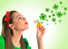 Beautiful woman making four leaf clover bubbles Royalty Free Stock Photo