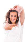 Beautiful woman making frame with her hands Royalty Free Stock Photo