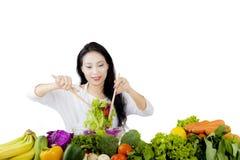 Beautiful woman making a healthy salad Royalty Free Stock Photos