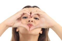 Beautiful woman making a heart shape Stock Photo