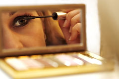Beautiful woman making her make up. With mirror Stock Image