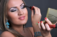 Beautiful Woman Making Her Makeup Royalty Free Stock Photography