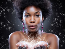 Beautiful woman making magic Stock Photo