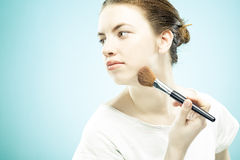 Beautiful woman making make-up Stock Photos