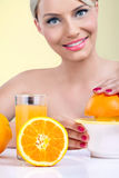 Beautiful woman making orange juice Royalty Free Stock Photos