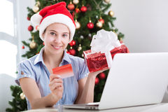 Beautiful woman making purchase online for xmas Stock Image