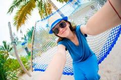 Beautiful woman making selfie relaxing at hammock Stock Photos
