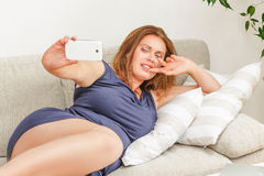 Beautiful woman making selfies at home Stock Image