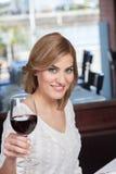 Beautiful woman making a toast Royalty Free Stock Photo