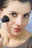 Beautiful woman making up Stock Image