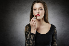 Beautiful woman making up her lips Royalty Free Stock Images