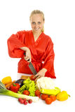 Beautiful woman making vegetable salad. Stock Photos