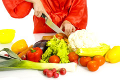 Beautiful woman making vegetable salad. Royalty Free Stock Photo