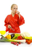 Beautiful woman making vegetable salad. Royalty Free Stock Image