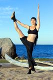 Beautiful woman is making yoga exercises Stock Photo