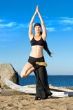 Beautiful woman is making yoga exercises Stock Photography