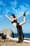 Beautiful woman is making yoga exercises Stock Images