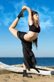 Beautiful woman is making yoga exercises Royalty Free Stock Photography