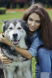 Beautiful woman with Malamute dog Stock Photo