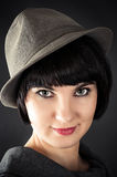 Beautiful woman in a male hat Royalty Free Stock Photo
