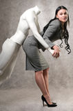 Beautiful woman and a male mannequin Stock Photography