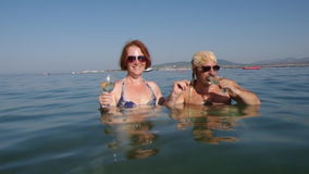 Beautiful  woman  and man  drinks  glass of champagne a stock footage