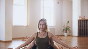 Woman shows a multi-armed form. Beautiful woman with many hands gesturing mudras sitting in lotus padmasana pose stock video footage