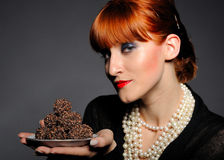 Beautiful woman with many truffel chocolates Stock Photo