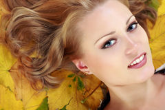 Beautiful woman with maple leaves Stock Images