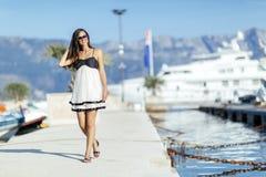 Beautiful woman in marina posing Royalty Free Stock Photo