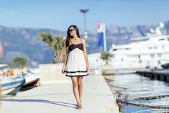 Beautiful woman in marina posing Stock Images