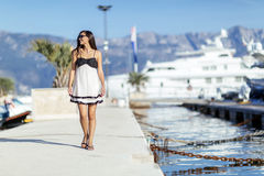 Beautiful woman in marina posing Stock Image
