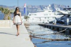 Beautiful woman in marina posing Royalty Free Stock Images