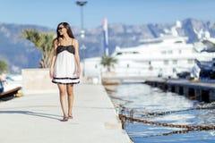 Beautiful woman in marina posing Stock Photo