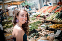 Beautiful woman at the market Stock Images