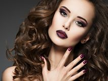 Beautiful woman with maroon nails royalty free stock photo