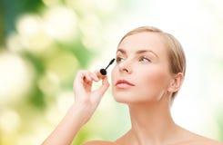 Beautiful woman with mascara Stock Photos