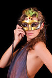 Beautiful woman in mask on black Stock Photography