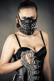 Beautiful woman in a mask with a chain. In hand Stock Photography