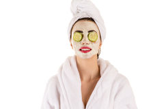 Beautiful woman with a mask on the face wellness. Isolated on white background stock photo