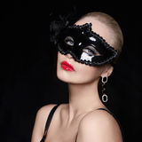 Beautiful woman in mask Royalty Free Stock Images