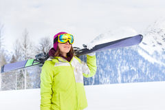 Beautiful woman in mask standing and holding ski Royalty Free Stock Photo